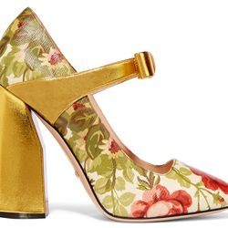 Floral, heeled mules with a gold heel.