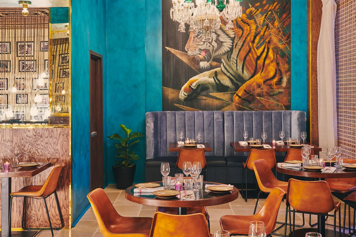 Gupshup's dining room wall has a tiger mural.