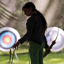 Ket Davis reaches for an arrow during an archery session at a Girl Scout day camp in Carnation, Wash., on Tuesday, June 26, 2018. As American women seek a larger role in politics, fairer wages and an end to sexual harassment, the Girl Scouts see an opportune time to show some swagger in promoting their core mission: girl empowerment. (AP Photo/Elaine Thompson)