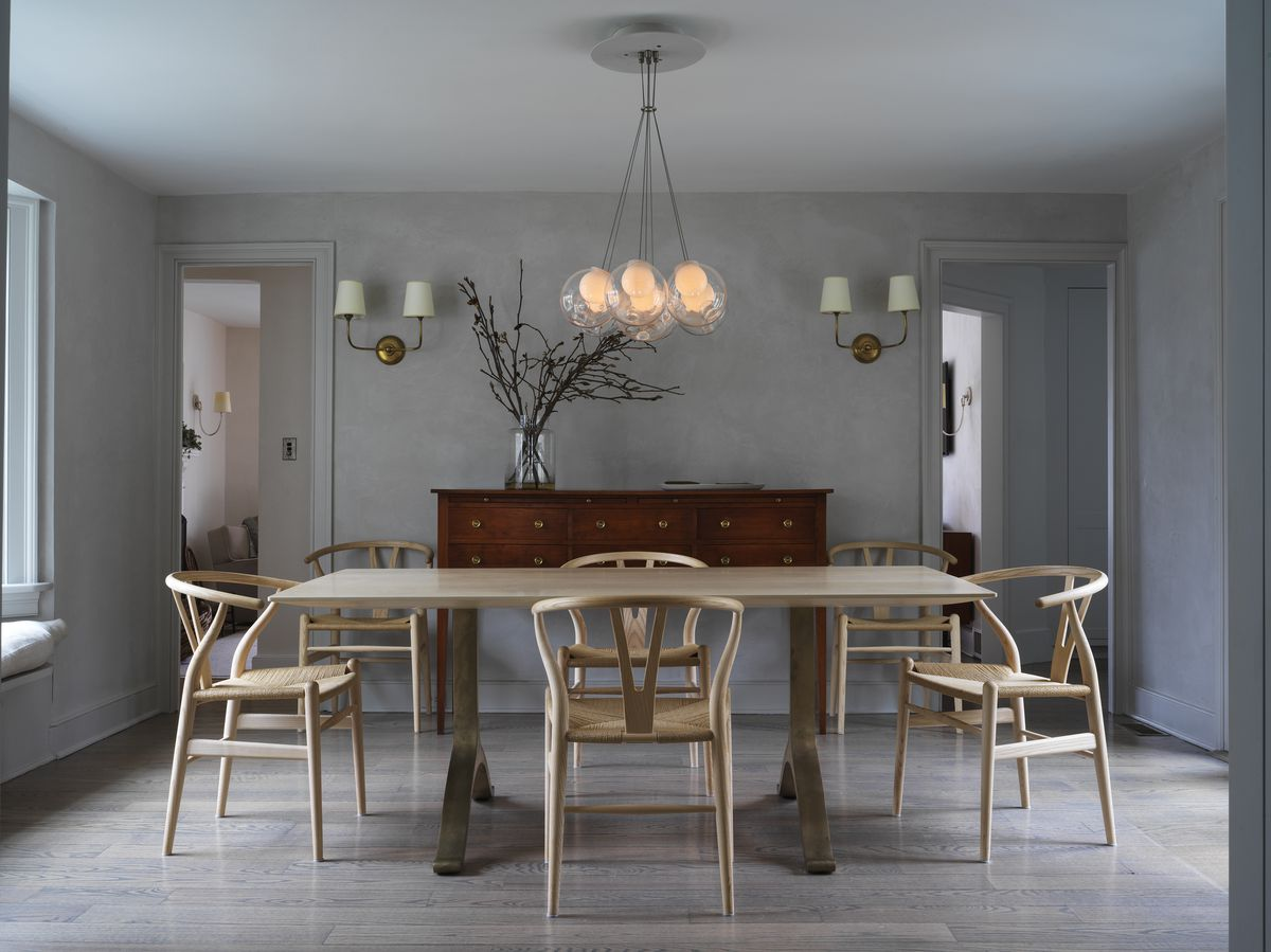 Dining room with pale wood dining table and matching chairs.
