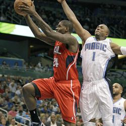 Atlanta Hawks' Marvin Williams (24) goes up past Orlando Magic's Von Wafer (1) for a shot during the first half of an NBA basketball game on Friday, April 13, 2012, in Orlando, Fla.