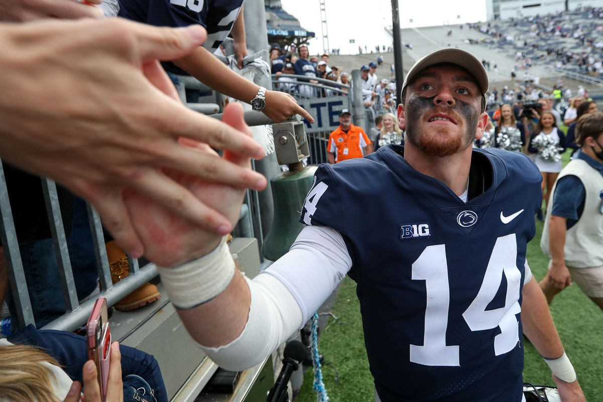 Penn State Nittany Lions quarterback Sean Clifford (14) shakes the hands of members of the Penn State student section following the completion of the game against the Villanova Wildcats at Beaver Stadium. Penn State defeated Villanova 38-17.