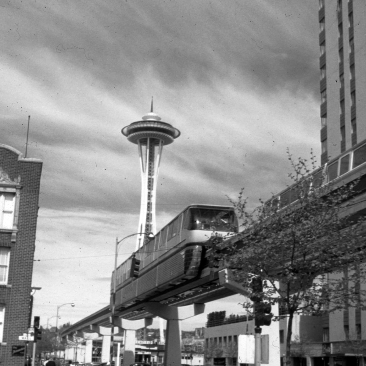 The monorail is pictured with, of course, the Space Needle.