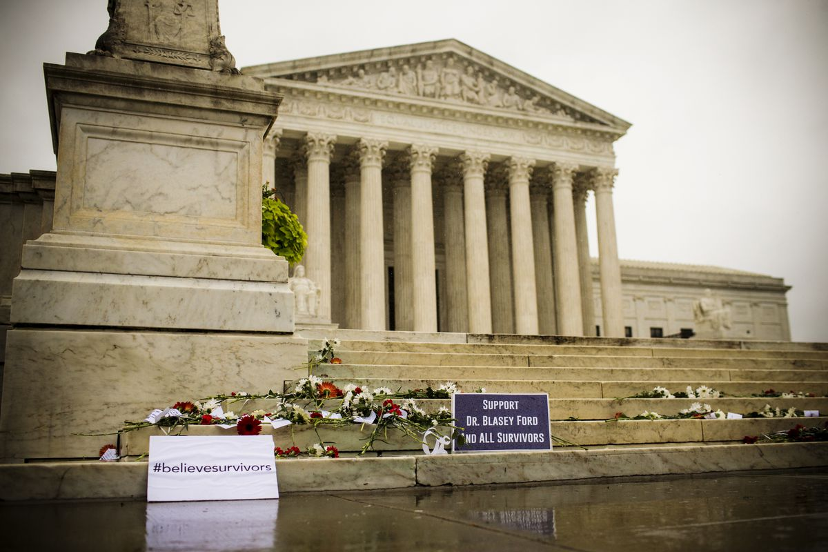 Flowers and notes supporting Christine Blasey Ford sit on the steps of the U.S. Supreme Court on September 27, 2018.
