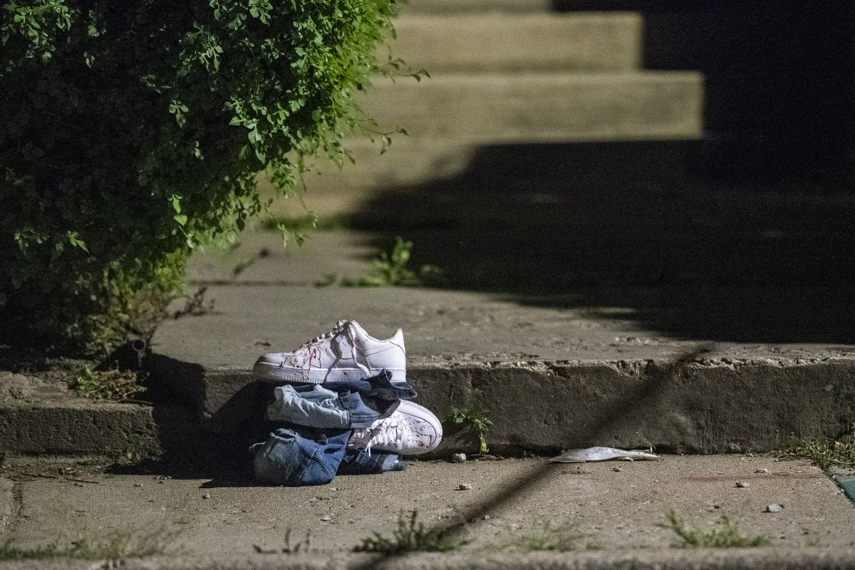 Blood covered clothing sits at the scene where a man was shot Sunday morning in the 4100 block of West Cullerton of the Lawndale neighborhood. | Tyler LaRiviere/Sun-Times