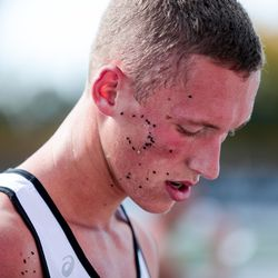 Morgan High's Kaleb Bowles has rubber pellets left on his skin after laying on the artificial turf field at the end of the 3A Boys State Cross-Country Championships at Highland High School in Salt Lake City on Wednesday, Oct. 23, 2019.