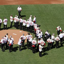 Former Boston Red Sox players, mangers and coaches gather on the field during ceremonies to celebrate the 100th anniversary of the first regular season baseball game at Fenway Park, before a game between the New York Yankees and the Red Sox in Boston, Friday, April 20, 2012.