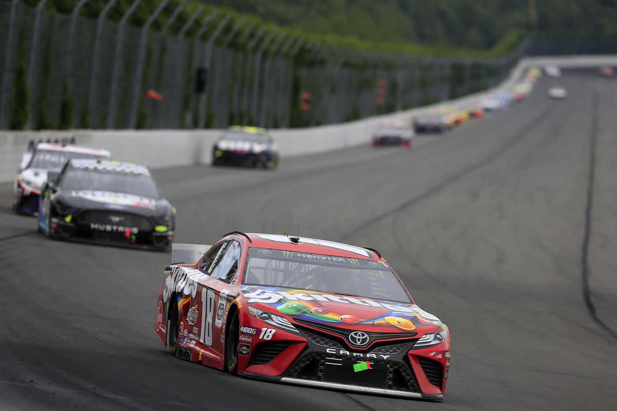 Kyle Busch, driver of the Skittles Toyota, leads a pack of cars during the Monster Energy NASCAR Cup Series Gander RV 400 at Pocono Raceway on July 28, 2019 in Long Pond, Pennsylvania.