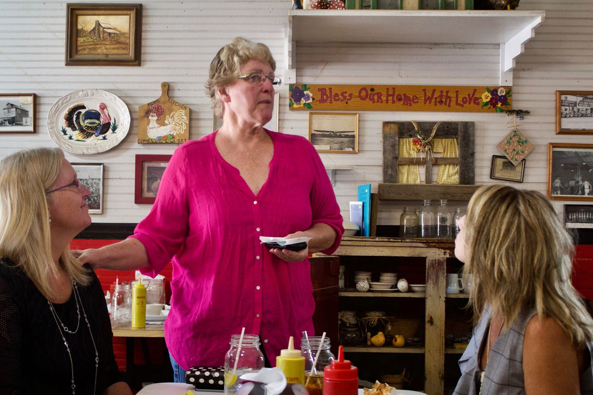Retired English teacher Peggy Allen, center, speaks with Otis Principal Michelle Patterson, left, and Superintendent Kendra Anderson at Mama's, the town's lone restaurant. (Photo by Nic Garcia)