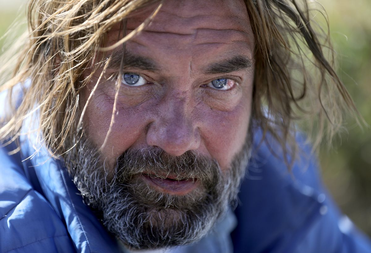 """David Bradford, who has been homeless for about a year, sits on a sidewalk outside of the Lantern House, a homeless shelter in Ogden, on Tuesday, Oct. 1, 2019. """"I'm ready to give up. I want to be buried right here,"""" he says, pointing to the ground next to the sidewalk."""