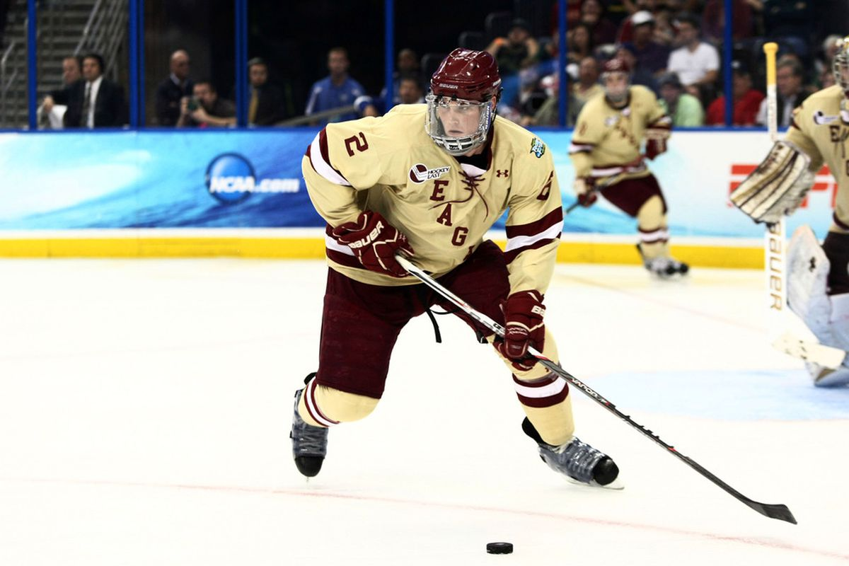 Apr 7, 2012; Tampa, FL, USA; Boston College Eagles defenseman Brian Dumoulin (2) passes the puck during the second period of the finals of the 2012 Frozen Four at Tampa Bay Times Forum. Mandatory Credit: Douglas Jones-US PRESSWIRE
