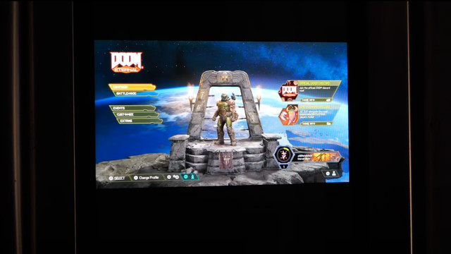 screenshot of a YouTube video showing Doom Eternal's title screen on the door of a Samsung Family Hub Smart Refrigerator