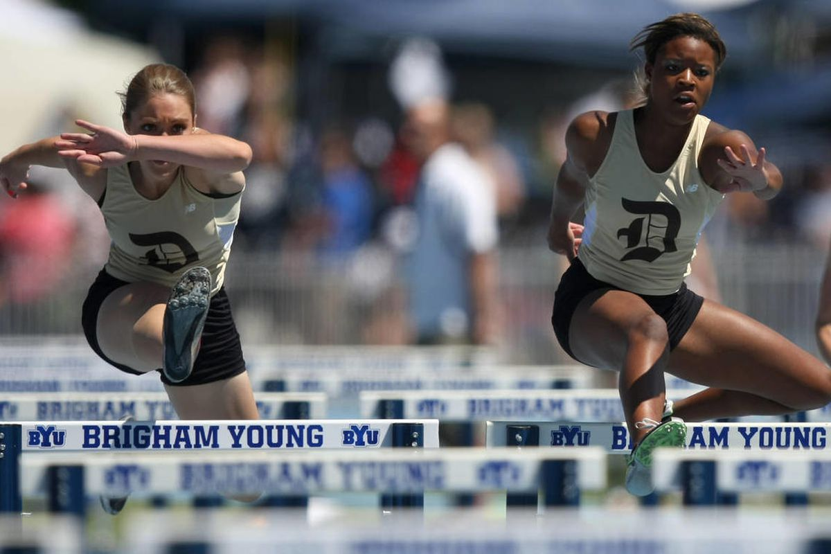 Adelyn Jones and Sylvia Harrison, of Davis High School, take second and first place respectively in the girl's 5A 100m hurdles during the state track and field championships at BYU in Provo on Saturday, May 21, 2011.