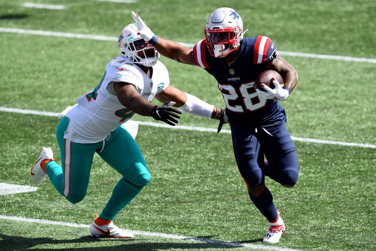 New England Patriots running back James White rushes against Miami Dolphins cornerback Byron Jones during the second quarter at Gillette Stadium