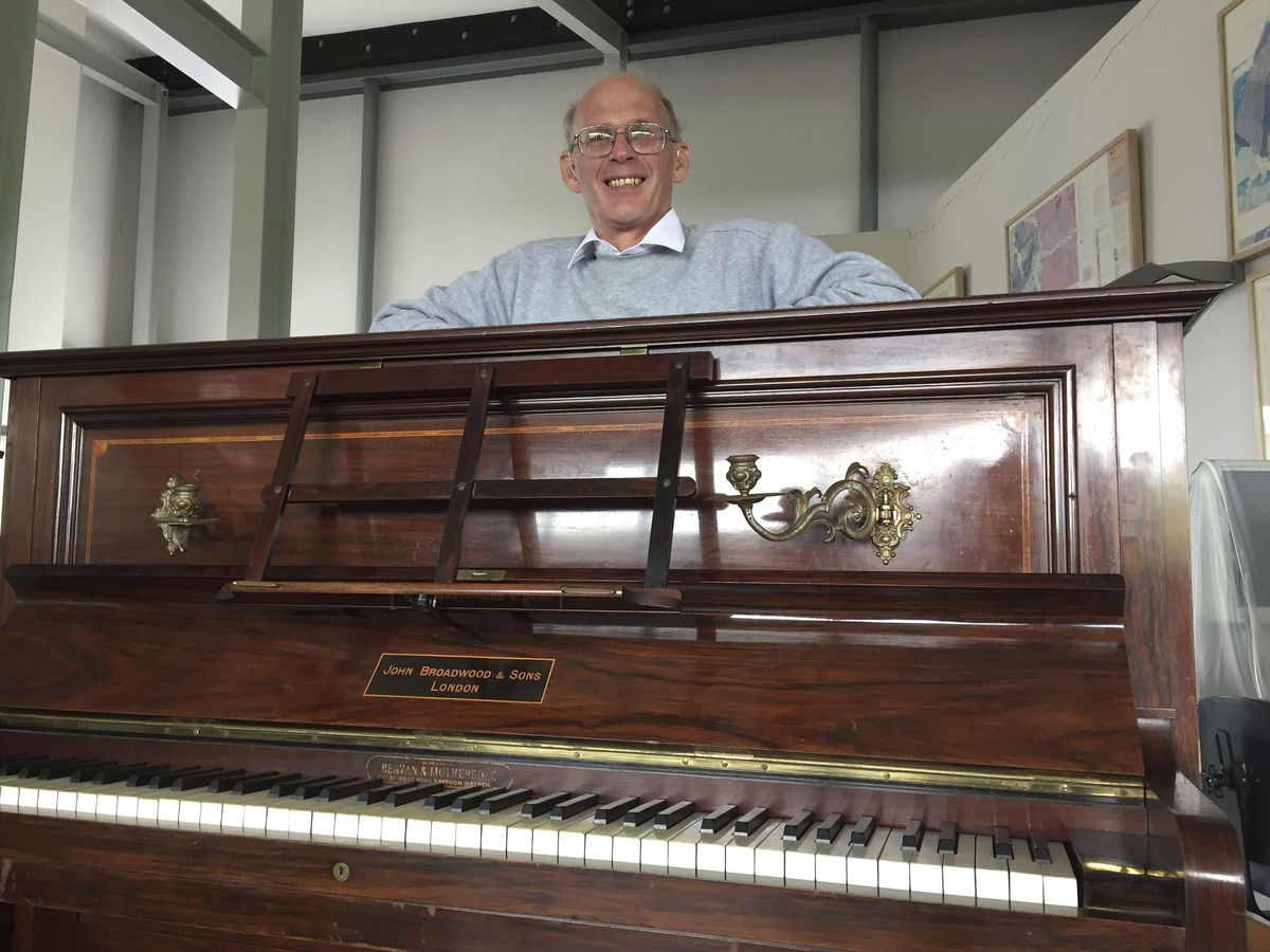 """Piano tuner Martin Backhouse found a stash of gold coins in this piano, now at the Ludlow Museum in  England. British officials say they have been unable to trace the rightful heirs to the coins, which they say are worth a """"life-changing"""" amount of money."""
