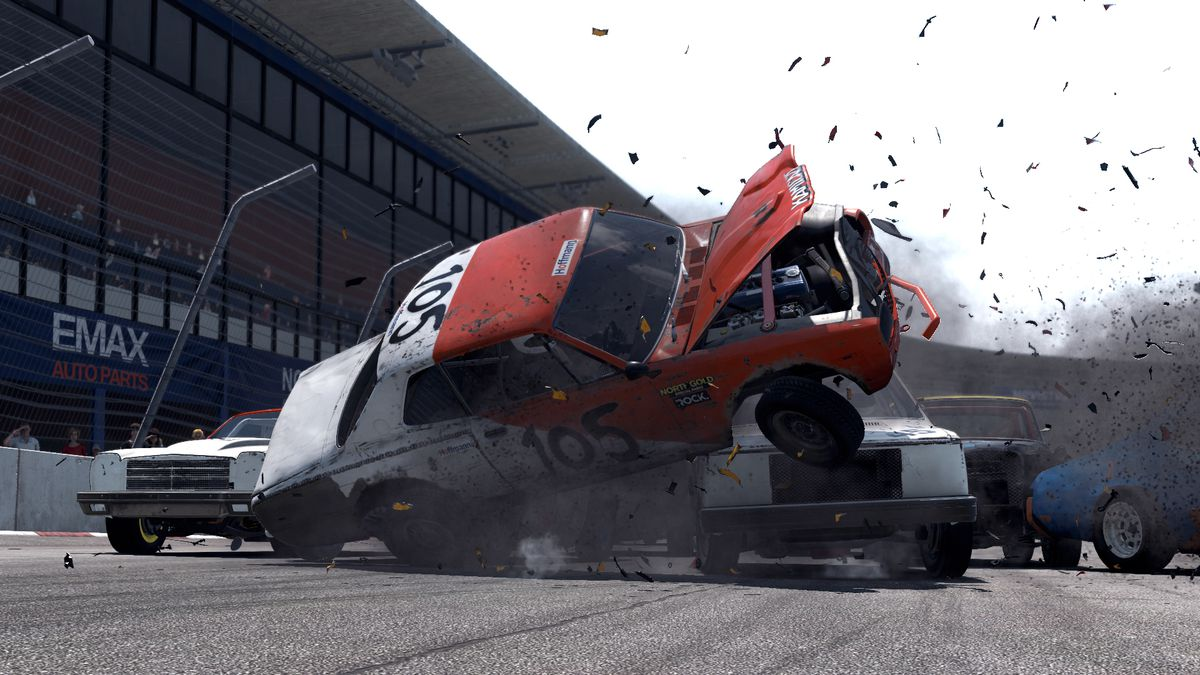 Debris sprays everywhere as one demolition racer t-bones another, turning it on its side, over the hard tarmac in Wreckfest