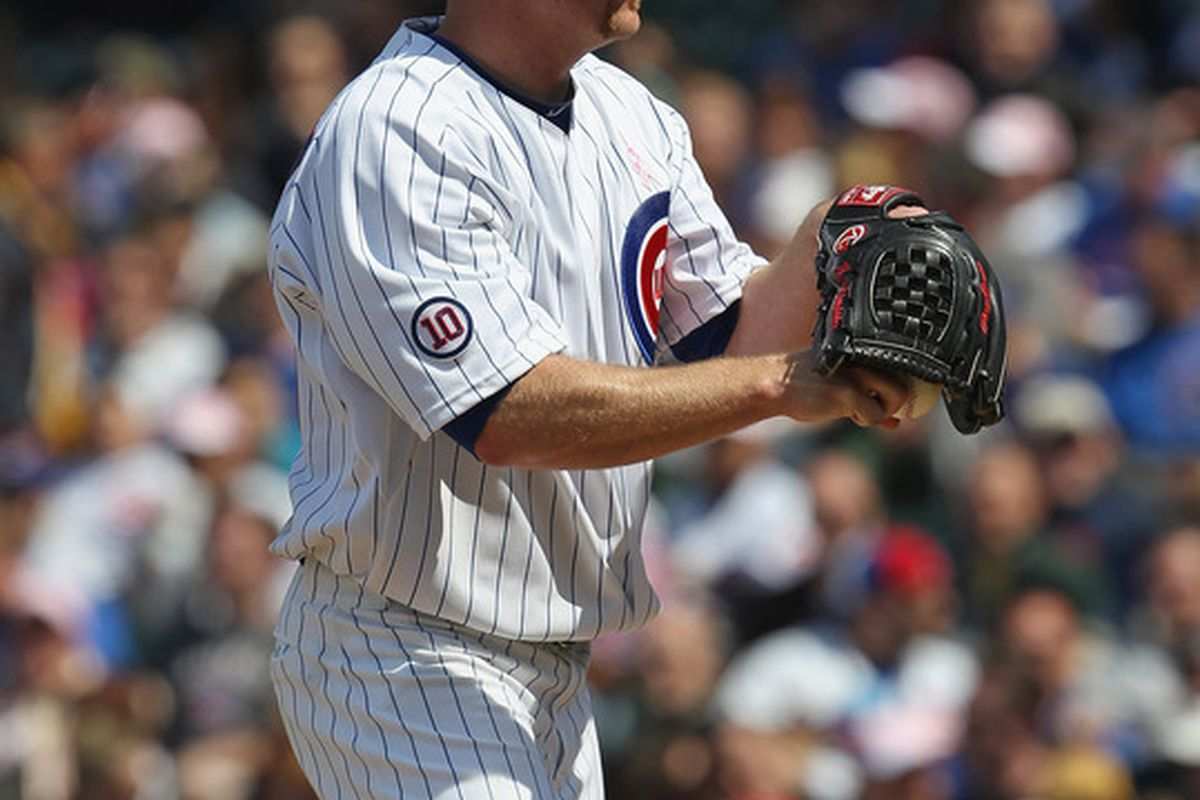 Starting pitcher Ryan Dempster of the Chicago Cubs prepares to throw against the Cincinnati Reds at Wrigley Field on May 8, 2011 in Chicago, Illinois. The Reds defeated the Cubs 2-0. (Photo by Jonathan Daniel/Getty Images)