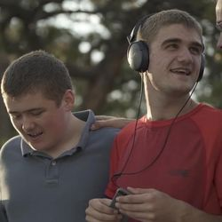 """Aaron Jepson, wearing headphones, has autism and is a member of the LDS Church. His story is among those featured in this year's """"Light the World"""" initiative."""