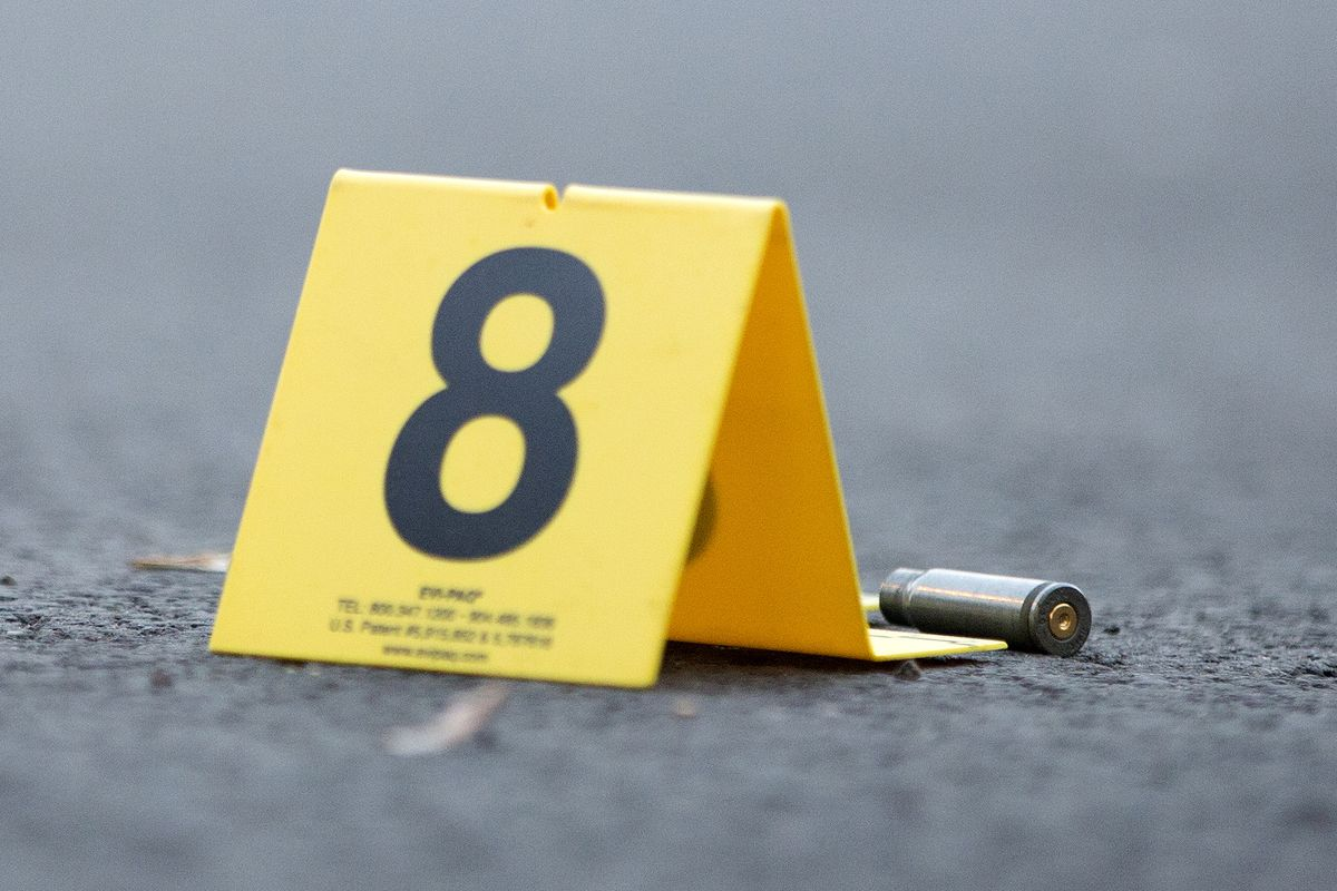 An evidence marker sits next to a rifle casing at the scene of a fatal shooting in the Back of the Yards neighborhood of Chicago in September 2016.