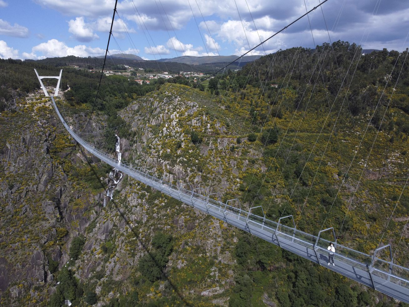 There are three requirements to walk across the newly opened Arouca Bridge in northern Portugal: You have to pay the fee. You must be accompanied by a guide. And, preferably, you don't have a fear of heights.
