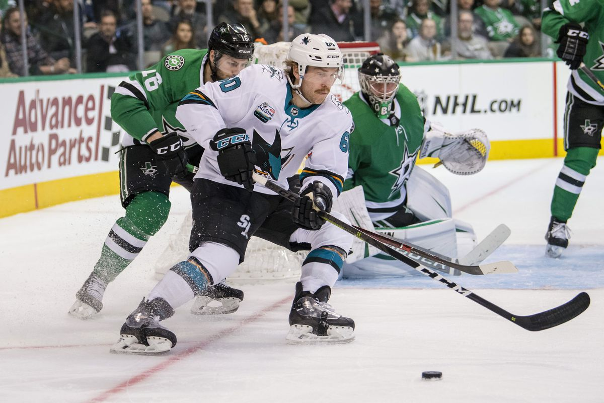 Nov 8, 2018; Dallas, TX, USA; San Jose Sharks center Rourke Chartier (60) controls the puck against Dallas Stars center Jason Dickinson (16) and goaltender Anton Khudobin (35) during the third period at the American Airlines Center.