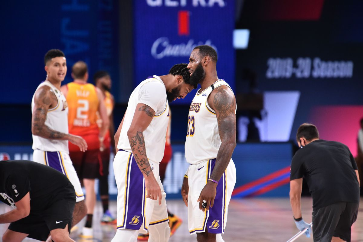 Anthony Davis of the Los Angeles Lakers and LeBron James of the Los Angeles Lakers talk during a game on August 3, 2020 at The Arena at ESPN Wide World Of Sports Complex in Orlando, Florida.