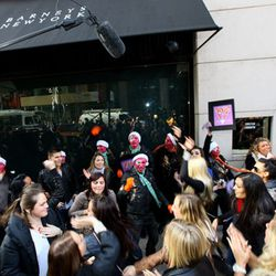 The street performers amass outside Barneys.