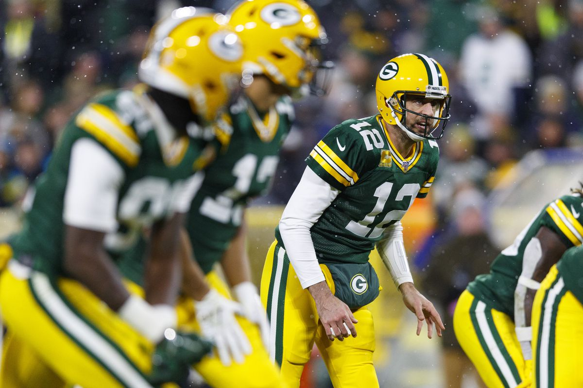 Green Bay Packers quarterback Aaron Rodgers waits for the snap against the Carolina Panthers during the first quarter at Lambeau Field.