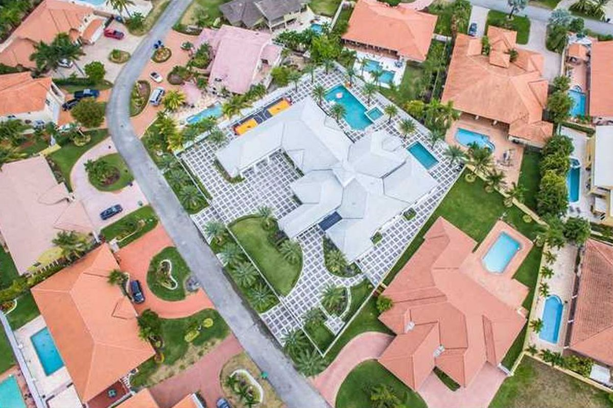 A view from above of a home with a gray roof for sale in Hialeah.