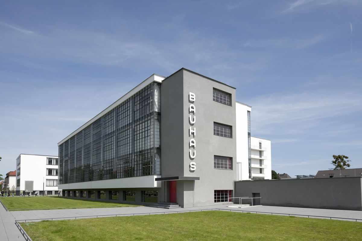 """Gray and white building with the word """"Bauhaus"""" on its facade."""
