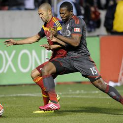 Real Salt Lake forward Alvaro Saborio (15) and Toronto FC defender Doneil Henry (15) battle for control of the ball during a game at Rio Tinto Stadium in Sandy on Saturday, March 29, 2014.