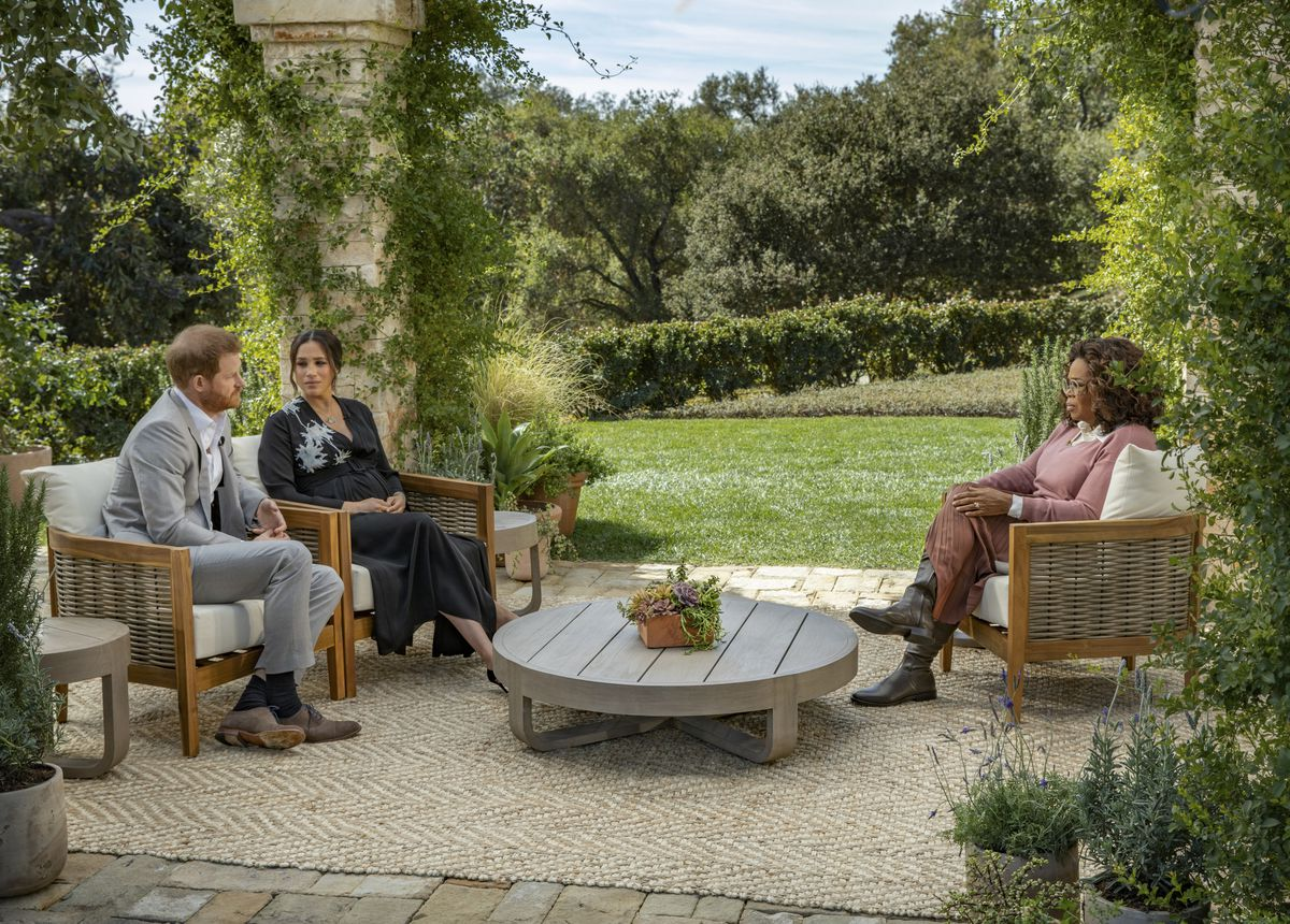 Prince Harry and Meghan Markle sit across from Oprah in a veranda