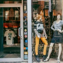 """<b>↑</b> <a href="""" http://www.thedressingroomnyc.com/""""><b>The Dressing Room</b></a> (75A Orchard Street) makes the transition from mimosas to shopping easier by combining its boutique with a full bar. You can browse indie designers here, dig for vintage t"""