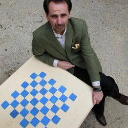 In this Wednesday, April 4, 2012, photo, Webster University provost Julian Schuster poses for a photo on the school's campus, in Webster Groves, Mo. Schuster was instrumental in bringing the defending national champion chess team from Texas Tech to little-known Webster University near St. Louis following a hefty financial commitment by the university according to team coach Susan Polgar.