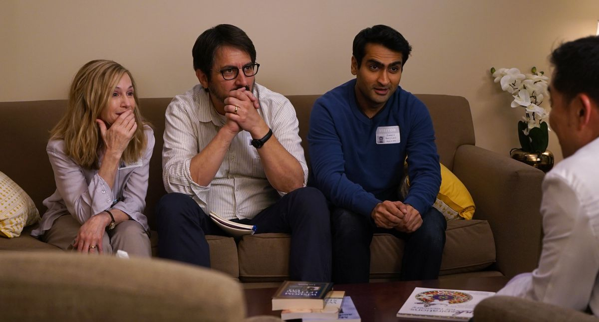 """Holly Hunter as """"Beth,"""" Ray Romano as """"Terry"""" and Kumail Nanjiani as """"Kumail"""" sit on a couch as a doctor delivers news"""