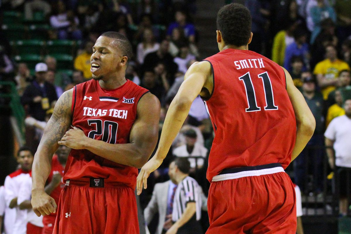 Toddrick Gotcher and Zach Smith celebrate during a timeout as the Red Raiders fell to Baylor 77-74