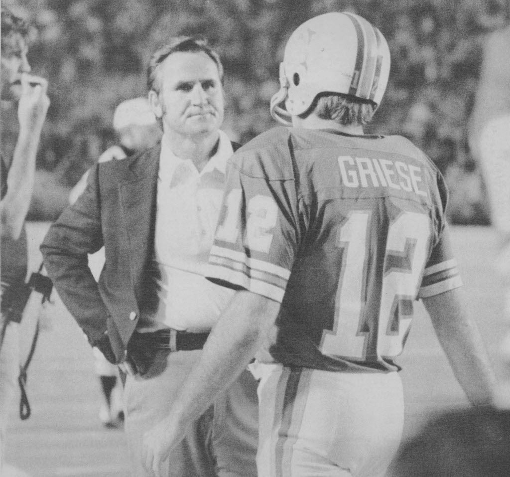 Miami Dolphin quarterback Bob Griese (12) might be trying to explain a faltering offense as he stands with coach Don Shula 12A during the second half of game with the Pittsburgh Stealers.Miami led at the half, 30-3, but the offense was shut out the rest o