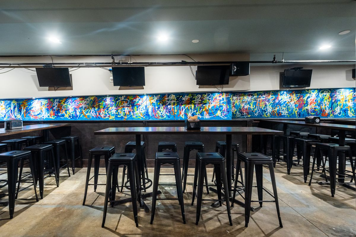 A strip of graffiti art covers one wall at Thirsty Crow