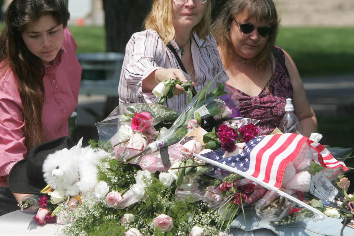 In this file photo, Rachael Norton places a rose on the grave of her daughter Destiny following funeral services for Destiny July 29, 2006.