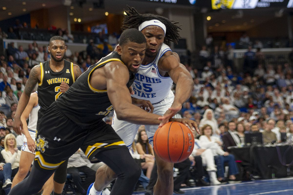 Memphis, Tennessee, USA; Memphis Tigers forward Precious Achiuwa and Wichita State Shockers forward Trey Wade fight for the ball during the second half at FedExForum.