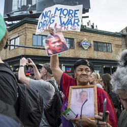 Anti-violence protesters rally outside Wrigley Field, shortly before a Chicago Cubs game, after marching and shutting down Lake Shore Drive near Belmont, Thursday afternoon, Aug. 2, 2018.   Ashlee Rezin/Sun-Times