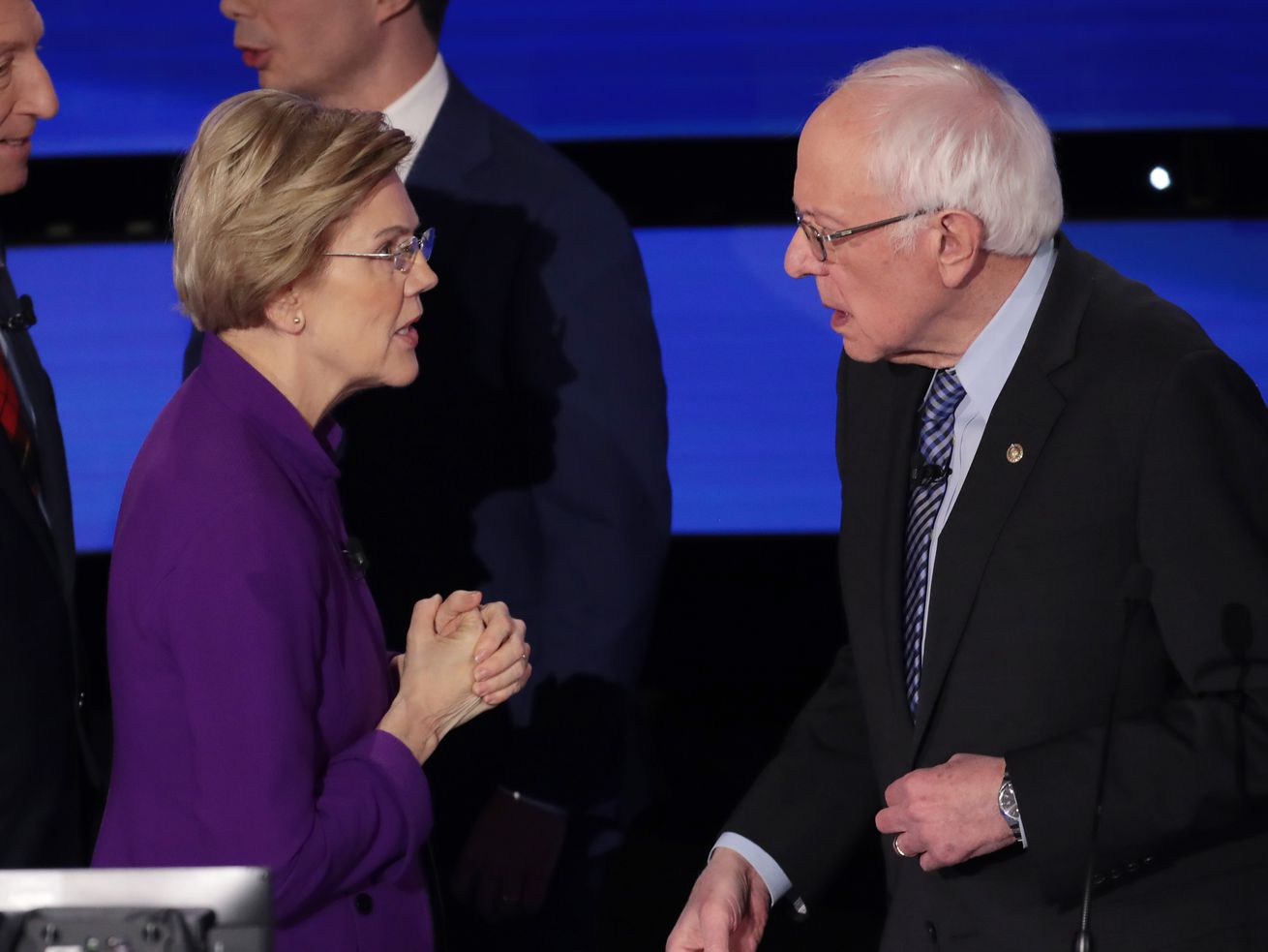 Warren and Sanders speaking after the debate.