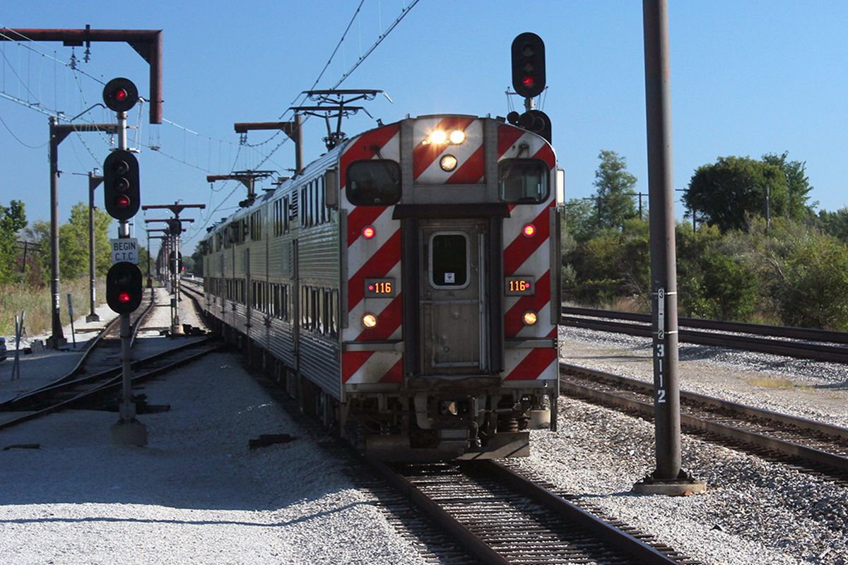 A Metra Electric train pulls into the University Park station.