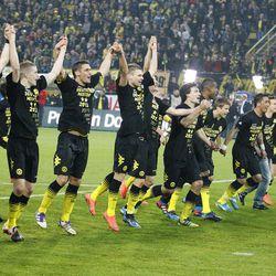 Dortmund players celebrate winning the German soccer championship after winning 2-0 in the German first division Bundesliga soccer match between Borussia Dortmund and Borussia Moenchengladbach in Dortmund, Germany, Saturday, April 21, 2012.