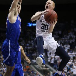 Brigham Young Cougars guard TJ Haws (30) tries to fake Texas Arlington Mavericks forward Jorge Bilbao (45) as BYU and the University of Texas at Arlington play in NIT basketball action at the Marriott Center in Provo, Utah on Wednesday, March 15, 2017.