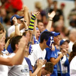 Bingham parents and fans cheer after a score as Bingham High School plays Euless (Texas) Trinity in the Kirk Herbstreit Varsity Football Series at Dallas Cowboys Stadium Monday in Arlington, Texas. Trinity won 42-21.