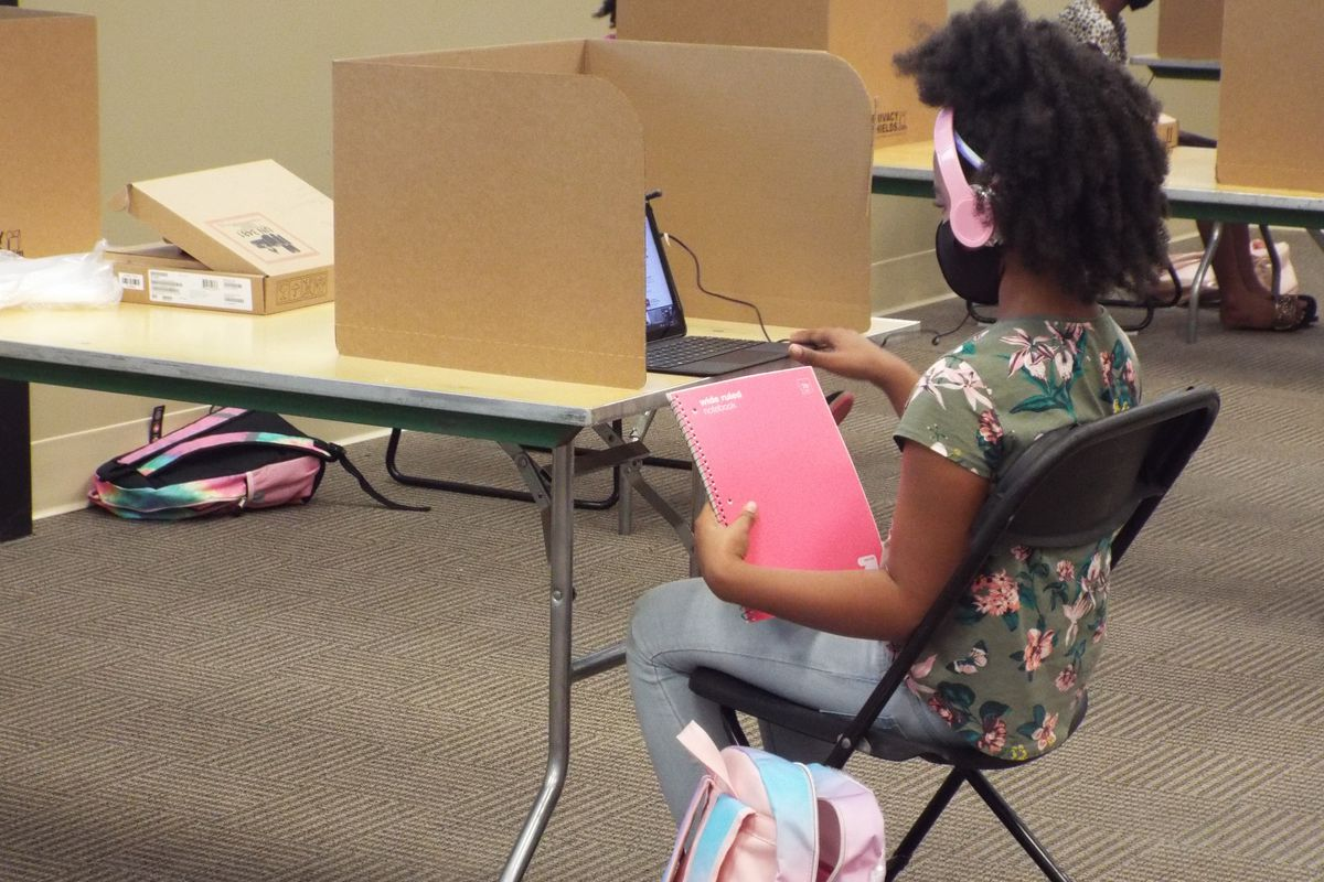 A student logs in remotely from the YMCA's virtual learning center in Cordova on the first day of school.