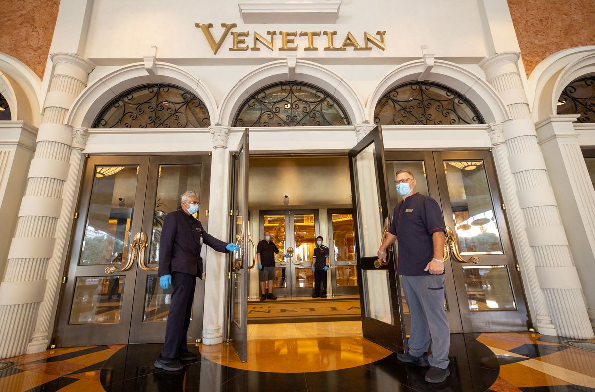 Employees at the Venetian welcome in guests on June 4.