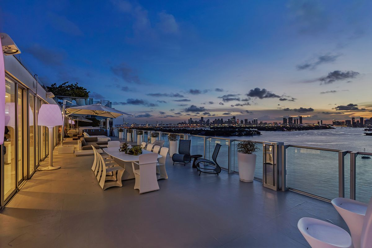 The terrace at Tower Suite #3 at the Mondrian South Beach, overlooking the bay at dusk