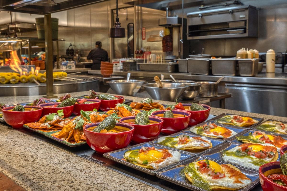 A variety of brunch dishes at a buffet